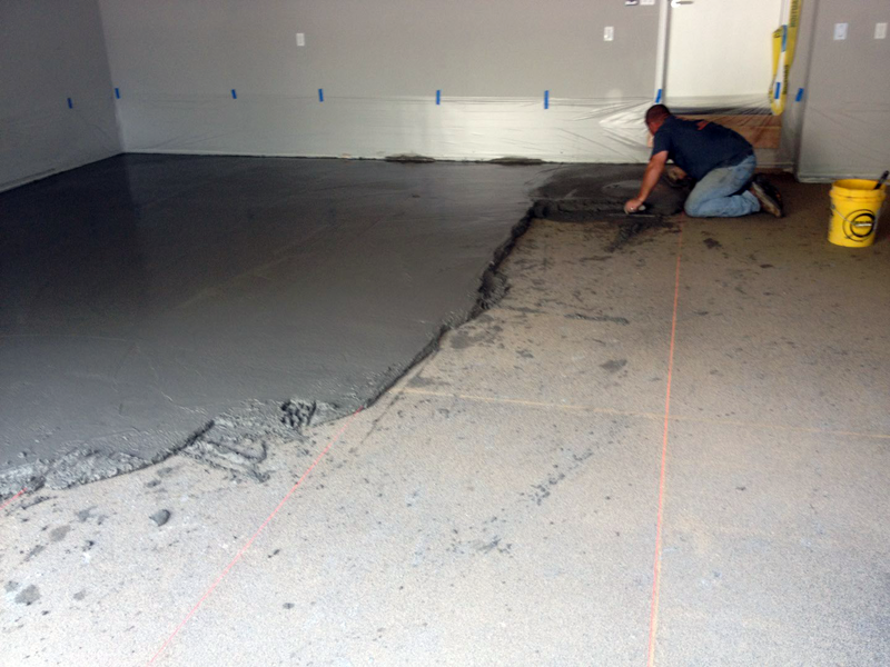 Fixing a Poorly Sloped Concrete Floor for Drainage - ConcreteIDEAS